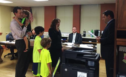 Lisa Cooper being sworn into office.